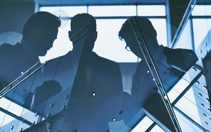 reflection-of-three-men-PXDYH77(1)